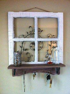 Old Window handpainted with a shelf of reclaimed materials. - Top 38 Best Ways To Repurpose and Reuse Old Windows