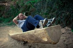 Outdoor gym / The sit-up station is made from one whole tree trunk, which is hand carved to form a sit-up platform
