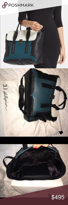 Phillip Lim Color Block Handbag In excellent condition! As close to NEW as you can get without the price! Comes with original dustbag & Phillip Lim Cards (2nd photo), only signs of wear is that white could be cleaned up to be pristine, but overall is great! Bag holds itself up in original shape, features double front zippers to allow bag to be bigger! Comes with cross body / shoulder strap-- pictured! No trades, given condition of handbag-- open to reasonable offers only! 3.1 Phillip Lim…