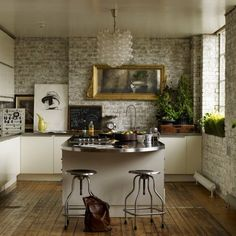 exposed brick kitchen walls brick walls in an london loft kitchen house to home via atticmag