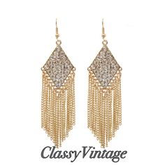 Gold tone jewel encrusted fringe earrings. Add some classy bling to your closet diet. These are long -three and one half inch long. Gold tone metal- Embellished diamond shape on top. Boutique Jewelry Earrings