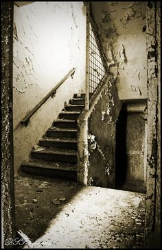 What door is at the bottom of my stair of pain and despair?  The stairwell of life I have been given and chosen, having no care Where does this door lead at my life's tortured end?   Central State Hospital, Milledgeville, GA.