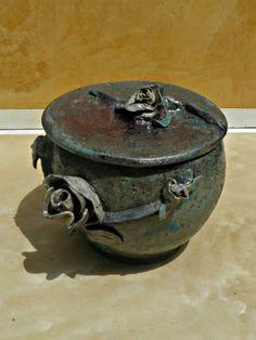 WHeel thrown, hand built Roses and Raku fired.