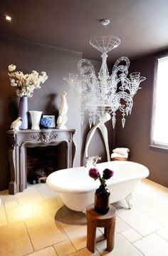 Roll top bath and a chandelier are the perfect luxuries for a bathroom #AbigailAhern
