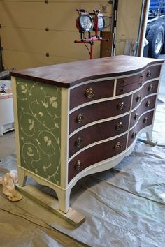 Stained dresser redo - some paint, some stain left, with different color pattern on the ends...