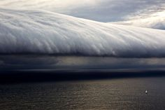 """In the Tasman Sea, off the southern coast of New South Wales, the 14.6m Scarlet Ribbon, a participant in the annual Sydney to Hobart yacht race, faces an ominous cloud formation. Photographer Carlo Borlenghi captured the image at 5pm, as the weather front, called a """"morning glory"""" moved in. Its a relatively rare roll-type cloud, can be more than 600 miles long – and often comes with violent squalls and wind shear. As featured in Boat International April 2012…"""