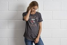 Tailgate Wisconsin Badgers T-Shirt by  American Eagle Outfitters   Back in the 1820's, Wisconsin miners lived in tunnels burrowed into hills during the winter. Today's tenacious Badger's football team honors their legacy. Shop the Tailgate Wisconsin Badgers T-Shirt and check out more at AE.com.