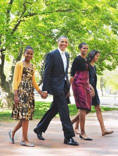 resident Barack Obama and First Lady Michelle Obama, with their daughters Sasha and Malia, walk across Lafayette Square from the White House for Easter Service at St John's Episcopal Church in Washington, DC.