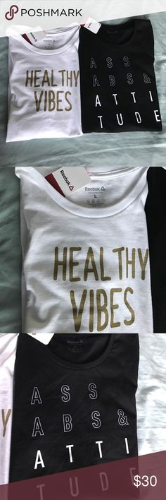 """Set of 2 🆕 Reebok Tees Set of 2 🆕 Reebok Tees Black & white - L - """"ASS ABS & ATTITUDE"""" White & gold - L - """"Healthy Vibes"""" 🖤🖤🖤 $30 for both or ask to purchase just 1 if you'd like!! Reebok Tops Tees - Short Sleeve"""