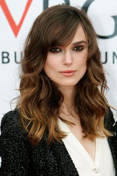 Keira Knightley Hair and Make-Up __ Simply gorgeous. A side-swept, long fringe adds face-framing shape to Keira's barnet, and this naturally-pretty colour looks fabulous against her peachy make-up, smouldering dark eyes and monochromatic outfit.