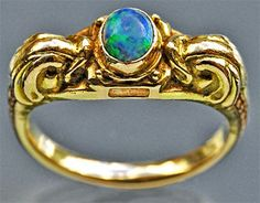 Joseph Hodel (attrib.). Arts and Crafts dolphin ring.  Gold and opal  Length: 0.7 cm Width: 2 cm  (Length: 0.3 in)  British, c. 1905. Sold by Tadema Gallery.
