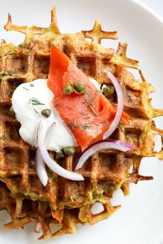 These veggie-packed latkes, are not your traditional latkes, they're made with shredded potatoes, carrots, zucchini and bell pepper, and they are cooked in a waffle iron so there's no need to fry! Top them with sour cream, lox and capers or with apple sauce on the side. #latkes #veggielatkes #waffleiron #hanukkah #recipes