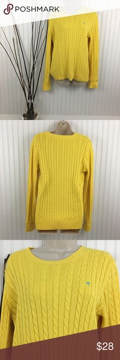 "LILLY PULITZER LONG SLEEVE CABLE KNIT SWEATER Yellow Lilly Pulitzer cable knit sweater. It has the classic palm tree in blue on the left Brest area. This sweater is in very good condition. 100% cotton. Approximate measurements flat across Chest: 19"" Waist: 17"" length: 24"" Lilly Pulitzer Sweaters Crew & Scoop Necks"