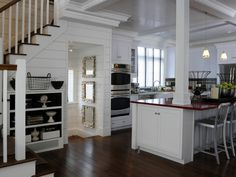 Love.....this is an hgtv dream...or green home....east coast......Love the stairs the open kitchen those shell frames...the open bookcase.....love