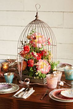 Beautiful birdcage wedding centerpiece http://rstyle.me/n/jdddznyg6