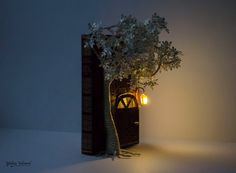 Door to a Secret Garden - Book Art - Book Sculpture - Altered Book The whole sculpture is made from a discarded book. The Led light is