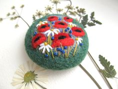Needle felted brooch Natural jewelry Wool felt brooch Flower brooch Felted jewelry Gift ideas for her Inspired by nature brooch  Unique handmade brooch with floral ornament. Felt brooch made of natural wool. The brooch could suitably adorn the coat, scarf, hat or dress. Brooch is fitted with a metal brooch pin. 6cm in diameter Please note that In reality colors of brooch may look slightly different than colors in photos on your screen. It depends on your monitor and its color rendering.