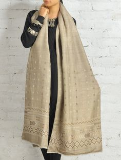 Ornate and elegant, this matka silk shawl with dupion-silk lining has been enhanced with Suf hand-embroidery.