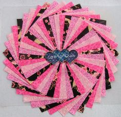 Oriental pinks Quilting fabric, Swirl Charm pack 5 inch squares 60 per pk.