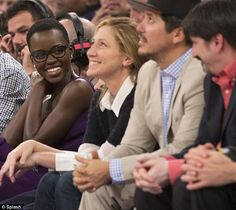 Hot seats: Lupita Nyong'o sat in the coveted courtside spots with Edie Falco and John Leguizamo to watch the New York Knicks play the Philadelphia 76ers at Madison Square Garden in New York on Wednesday