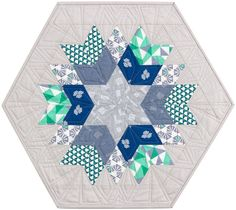 Rock Candy designed by Jaybird Quilts. Features #FragmentalFabric by Angela Walters, shipping to stores November 2015. Charm friendly! Three color stories. #rockcandyquilt