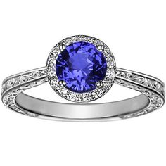 18K White Gold Sapphire Contessa Ring from Brilliant Earth.This ornate antique-style halo setting is adorned with intricate scrolling detail on all sides
