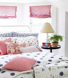 Contrasting colors and sizes keep the space from looking too uniform and can be both whimsical and charming.  (Duvet cover with matching pillowcases from Ikea, tan pillowcases from garnethill.com, gingham pillow fabric from bandjfabrics.com)
