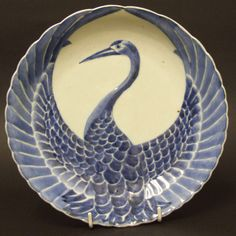 An 18th Century Japanese Porcelain Dish from the Arita Kilns. The Dish has Moulded Relief Decoration in the Form of a Crane with Outstretched Wings Which is Decorated in Blue and White. For a very similar 18th century Japanese porcelain dish but decorated in enamels in addition to blue and white see : Japanese Export Porcelain, Catalogue of the Collection of the Ashmolean Museum, Oxford (Oliver Impey, Hotei Publishing, Amsterdam,2002) page 242 plate 426.