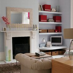 Built-in living room storage with bright binders and baskets over computer table