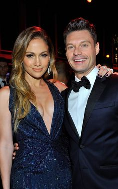 Pin for Later: Hot Hollywood Stars Trade Halloween Costumes For Red Carpet Glamour  Ryan Seacrest was all smiles around Jennifer Lopez.