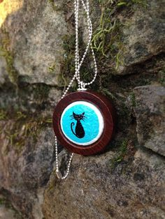 mod dark teal kitty miniature painting wine cork necklace by quarkcorks on Etsy