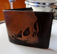 Hand Tooled Leather Skull Wallet... i WANT/NEED this so bad. I've never had a wallet because i never EVER see any that i like.