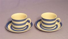 A superb vintage pair of T G Green cornishware cups & saucers  Beautiful blue and white striped ceramic cups & saucers  T G Green Cloverleaf backstamp to base c 1980  Both cups and saucers are in good original condition, some age crazing to one cup & tiny flea bites to other cup rim only {see photo}  Popular and successful, Cornish Ware expanded steadily through the 1930s and into the 1950s and was widely imitated, though never bettered. Cornishware, Antiques Online, Ceramic Cups, Cooking Utensils, Cup And Saucer, 1930s, Blue And White, Base, Ceramics