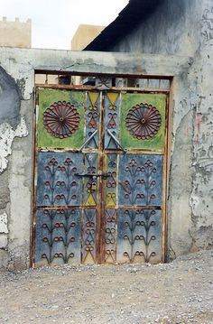 Blue and green doors. Oman. I know it is not an owl, but it looks like one to me! Of course, everything I look at, I see owls!