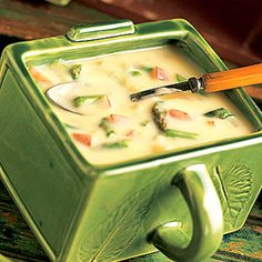 Asparagus & Cheese Potato Soup - A treasure of spring--tender, purple-tinged asparagus--is featured in this soup. Sour cream lends a tangy flavor to this creamy delight.