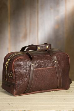 Our Bison Weekender is a showpiece duffel bag with the luxurious pebbled texture of American bison leather.