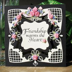 Poppy Stamps Angel Corner die used to make this black and white square die-cut and rubber-stamped card, with quilled roses, by cre8nart