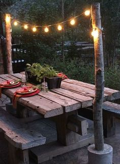 You might never use your kitchen table again if your outdoor dining area looked like this! #deck #design #fairylights