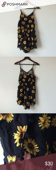 BKMGC sunflower romper Adorable like new sunflower romper. Black with golden yellow sunflowers! Perfect festival boho look. Pom Pom detailing on outer seam of bottom of romper as pictured. Zips in the back. Adjustable straps. Light flowy material. 100% polyester. Hand wash or dry clean only. Bust: 16 in across. Waist: 14 in across unstretched and goes up to 18 in across when stretched. Length from middle of top to crotch seam: 21 in. Side length from armpit to bottom of shorts: 19 in. BKMGC…