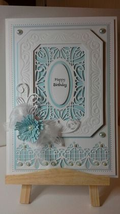 Crafty cardz, A 10x7 card blank,i pierced the edges of the card with a tim holtz piercing ruler, i also used sue wilson grand noble rectangles die and sues corn flower die and gemini border die,please feel free to visit my blog at http://simplycraftycardz.blogspot.co.uk