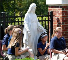 Nearly 800 students, staff, clergy and parents filled the St. Mark School courtyard to celebrate the Feast of Our Lady of the Rosary.