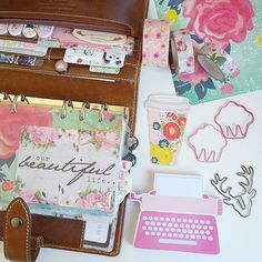 Florals, cup cakes, typewriter.....good stuff. :D #filofax