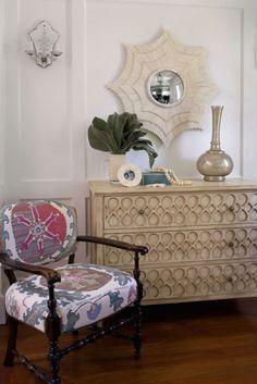Love, love, love!  Bone sunburst mirror is from Blackman Cruz; Murano dresser from Mecox Gardens; chair fabric is Tashkent silk from Hollyhoc