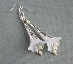 MOVING SALE! Reduced to just $10.00! Serenity Earrings, I can visualise these beautiful earrings been worn by a blushing bride on her special day. Created with beautifully simple, pure white lucite flowers, Topped with silver filigree and finished with czech glass pearl beads. Measuring just under 8.5 cm (3.1/3 inches) long, from the top curve of the silver tone hypoallergenic hooks to the bottom of the dangles. All metals are Silver tone and lead and Nickle free. Please...