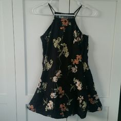 Brandy Melville black floral abigail dress Flaw shown in picture (light black/gray streak on bottom of dress) Brandy Melville Dresses Mini