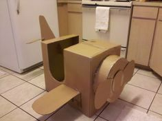 Throwin' an airplane theme party on a budget--Here's a great cardboard box airplane. Add a little paint to jazz it up and you've got a super photo-op in the making.