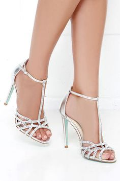 What better way to standout and shine than in the Blue by Betsey Johnson Ruby Silver Rhinestone Heels! These breathtaking dress sandals have metallic faux leather straps topped in glimmering rhinestones, and a strappy peep-toe design. Glitter Heels, Stiletto Heels, Glitter Toms, Glitter Paint, Silver Rhinestone Heels, Prom Shoes Silver, Silver High Heels, Silver Sandal Heels, Silver Heels Wedding