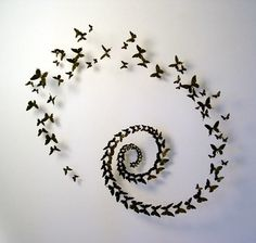 Paul Villinski makes these wonderful butterflies out of beer cans and arranges them in amazing configurations. Check out his web site here ....