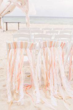 #chair-decor, #ribbon, #chair  Photography: Brandon Kidd Photography - brandonkidd.net  Read More: http://www.stylemepretty.com/2014/08/12/intimate-playa-del-carmen-destination-wedding/