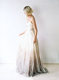 Traditional meets modern in this stunning statement gown. The daring look of its low, lace-up back is balanced by the demureness of its sweetheart neckline. Its most defining feature is its bias-cut lace skirt, dip-dyed to create an oyster-hued ombré effect.   Photo by Blush Wedding Photography